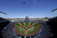 A B-2 Stealth Bomber flies over Kauffman Stadium before a baseball game between the Kansas City Royals and the Texas Rangers on Thursday, April 1, 2021, in Kansas City, Mo. (AP Photo/Charlie Riedel)