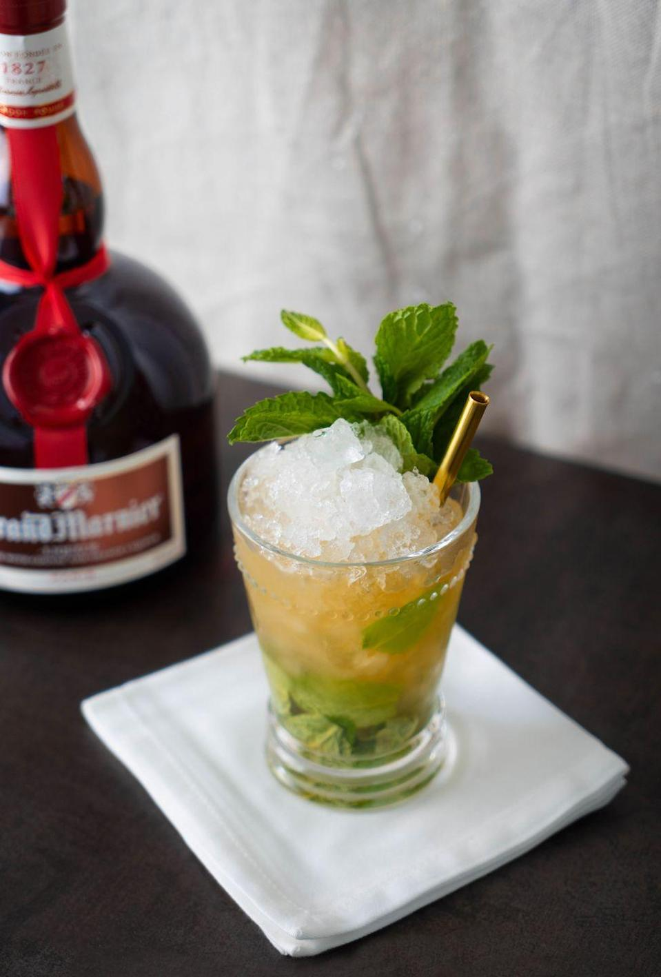"""<p><strong>Ingredients</strong></p><p>2 oz Grand Marnier Cordon Rouge<br>10-15 fresh mint leaves </p><p><strong>Instructions</strong></p><p>Slap the mint and set it inside the bottom of a rocks glass or julep cup. Add the Grand Mariner and gently muddle. Top with crushed ice to the top of the cup or glass until it forms a cone. Garnish with a bouquet of fresh mint.<strong><br></strong></p><p><strong>More:</strong> <a href=""""//www.townandcountrymag.com/leisure/drinks/how-to/g667/kentucky-derby-mint-julep-guide/"""" data-ylk=""""slk:How to Make a Classic Mint Julep"""" class=""""link rapid-noclick-resp"""">How to Make a Classic Mint Julep</a></p>"""