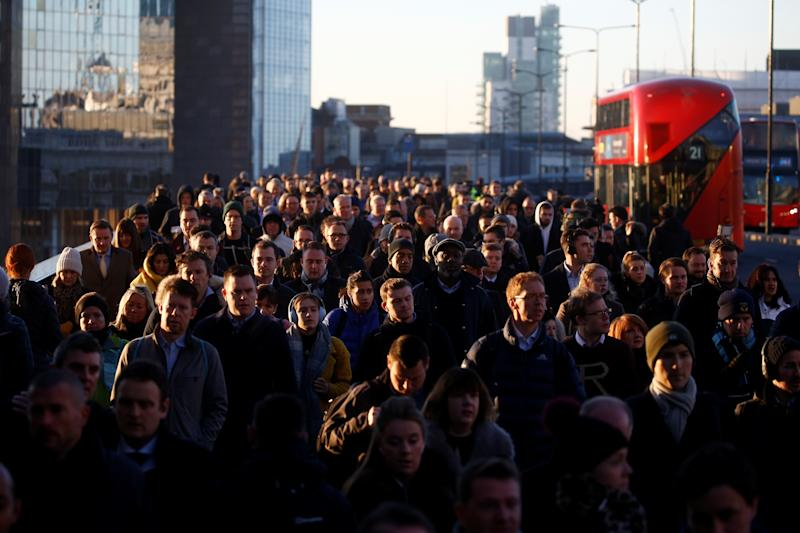 Commuters on London Bridge. Photo: REUTERS/Henry Nicholls