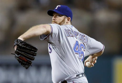 Texas Rangers starting pitcher Ryan Dempster throws to a Los Angeles Angels batter during the first inning of a baseball game in Anaheim, Calif., Tuesday, Sept. 18, 2012. (AP Photo/Jae C. Hong)