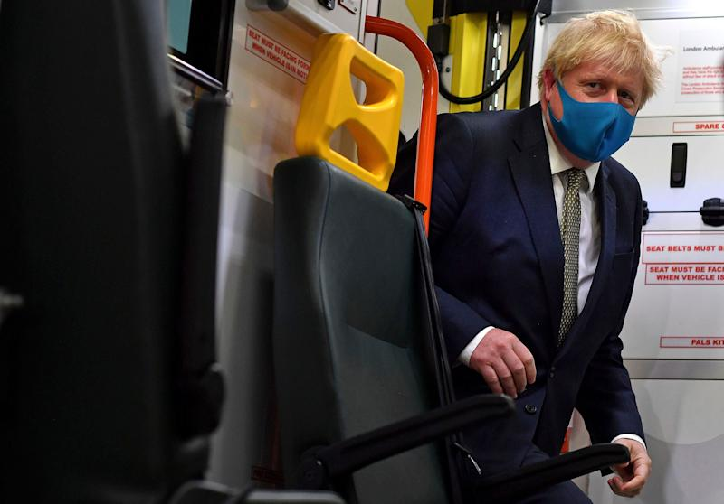 Prime minister Boris Johnson boards an ambulance during a visit to the headquarters of the London Ambulance Service NHS Trust in London (Photo: ASSOCIATED PRESS)