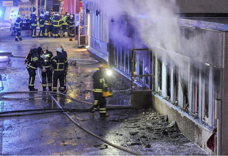 Smoke rises from a mosque as firefighters search the building after it was destryoed in an arson attack on December 25, 2014, in Eskilstuna, Sweden