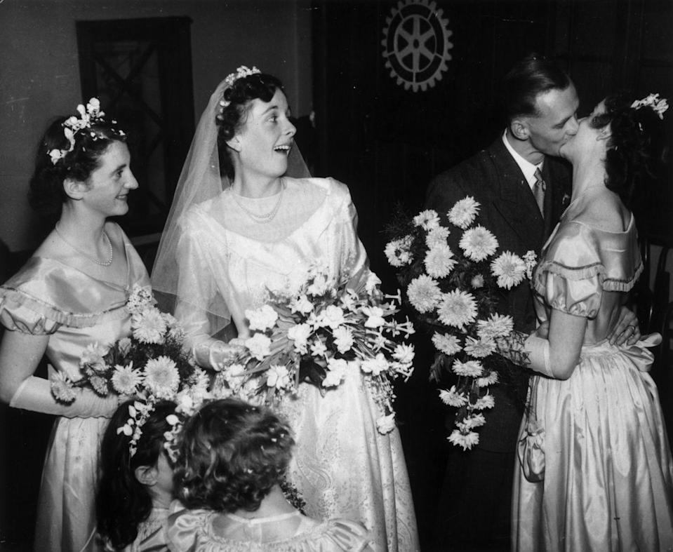 <p>A passionate kiss isn't out of place at a wedding, but note the parties in lip-lock: The groom ... and a bridesmaid. Perhaps they had a good laugh about it?</p>