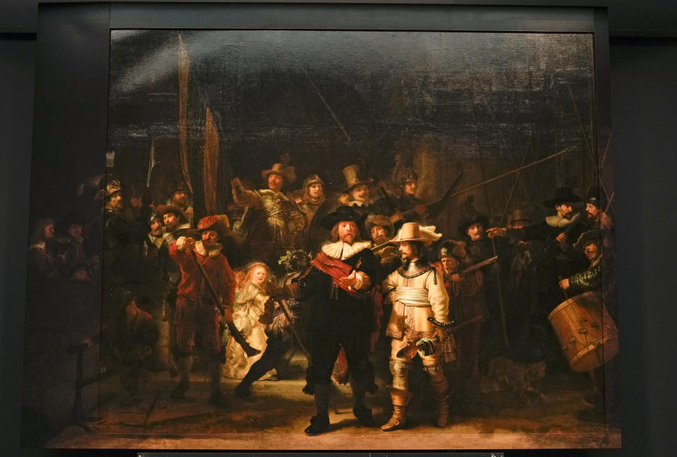 View of Rembrandt's biggest painting the Night Watch which just got bigger with the help of artificial intelligence, see added sides, in Amsterdam, Netherlands, Wednesday, June 23, 2021. The Dutch national museum and art gallery Rijksmuseum reveals findings from a long-term project to examine in minute detail Rembrandt van Rijn's masterpiece the Night Watch. (AP Photo/Peter Dejong)