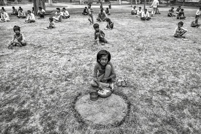 The homeless were fed meals in open grounds