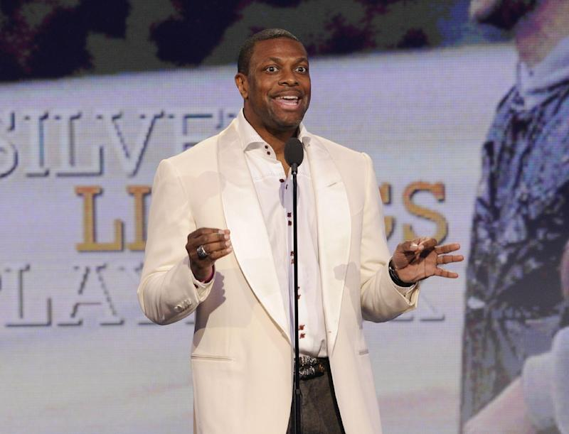"""FILE - This Feb. 23, 2013 file photo shows actor Chris Tucker speaking onstage at the Independent Spirit Awards in Santa Monica, Calif. announced Tuesday, April 16, that the comedian-actor will host the show June 30 from the Nokia Theater in Los Angeles.  Tucker is riding high off of his supportive role in the Oscar-nominated film """"Silver Linings Playbook,"""" which starred Jennifer Lawrence and Bradley Cooper. The 41-year-old is best known for his starring in the """"Rush Hour"""" film franchise opposite Jackie Chan. (Photo by Chris Pizzello/Invision/AP, file)"""