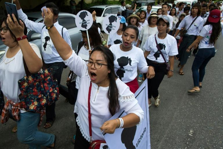 "A Facebook campaign has gathered momentum as people changed their profile photos to call for ""Justice for Victoria"" -- a pseudonym given to the girl (AFP Photo/Sai Aung MAIN)"