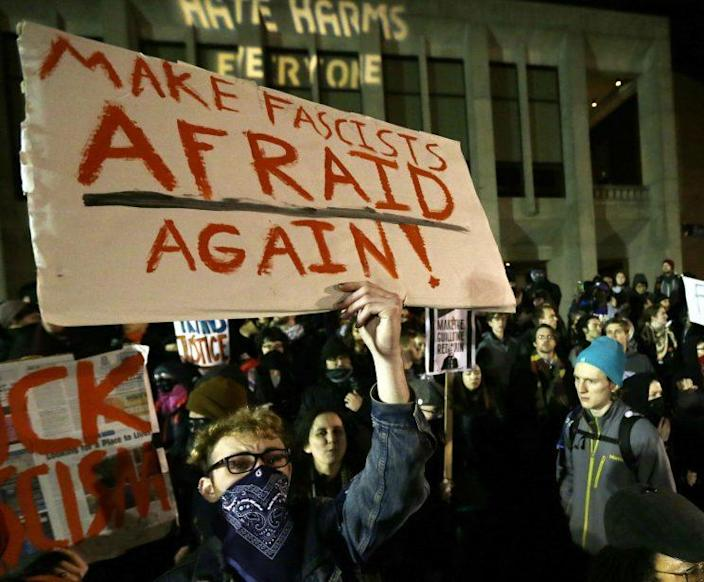 A demonstration on Jan. 20 at the University of Washington, where far-right commentator Milo Yiannopoulos was giving a speech. (Photo: Ted S. Warren/AP)