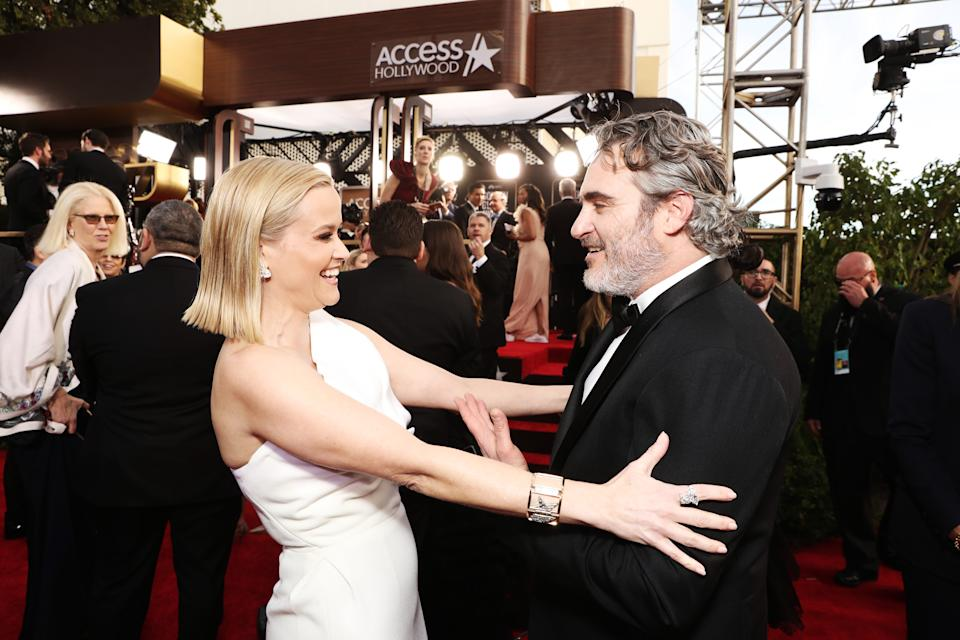 BEVERLY HILLS, CALIFORNIA - JANUARY 05: 77th ANNUAL GOLDEN GLOBE AWARDS -- Pictured: (l-r) Reese Witherspoon and Joaquin Phoenix arrive to the 77th Annual Golden Globe Awards held at the Beverly Hilton Hotel on January 5, 2020. -- (Photo by: Todd Williamson/NBC/NBCU Photo Bank via Getty Images)