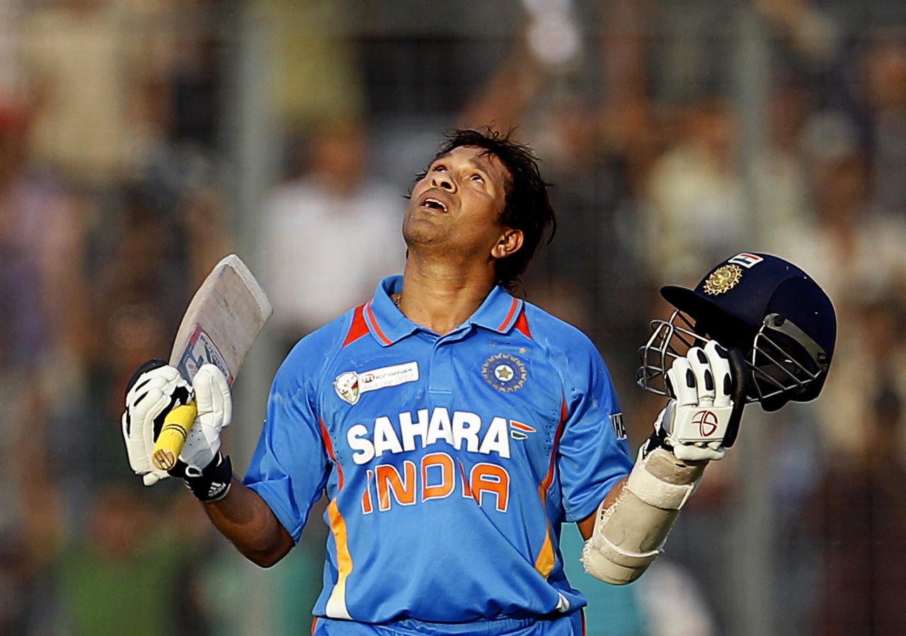 Indian cricketer Sachin Tendulkar celebrates scoring his 100th century during the Asia Cup cricket match against Bangladesh in Dhaka, Bangladesh, Friday, March 16, 2012. Tendulkar, who had been stuck on 99 centuries for a year, became the first cricketer to score 100 international centuries on Friday when he hit to square leg and ran a single against Bangladesh in the Asia Cup. (AP Photo/Aijaz Rahi)