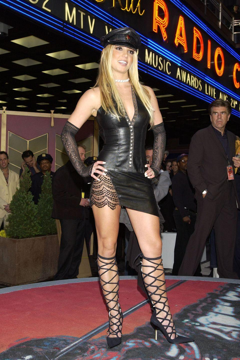 <p>Ah Britney, we're pretty sure you must have woken up that morning and thought 'how could I go wrong with a leather, studded mini with matching cap, lace gloves and lace-up shoes?'. So innocent.</p>