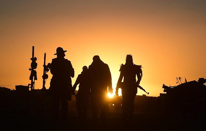Festival goers arrive for the first day of Wasteland Weekend in the Mojave Desert, California, the world's largest post-apocalyptic festival (AFP Photo/Frederic J Brown)