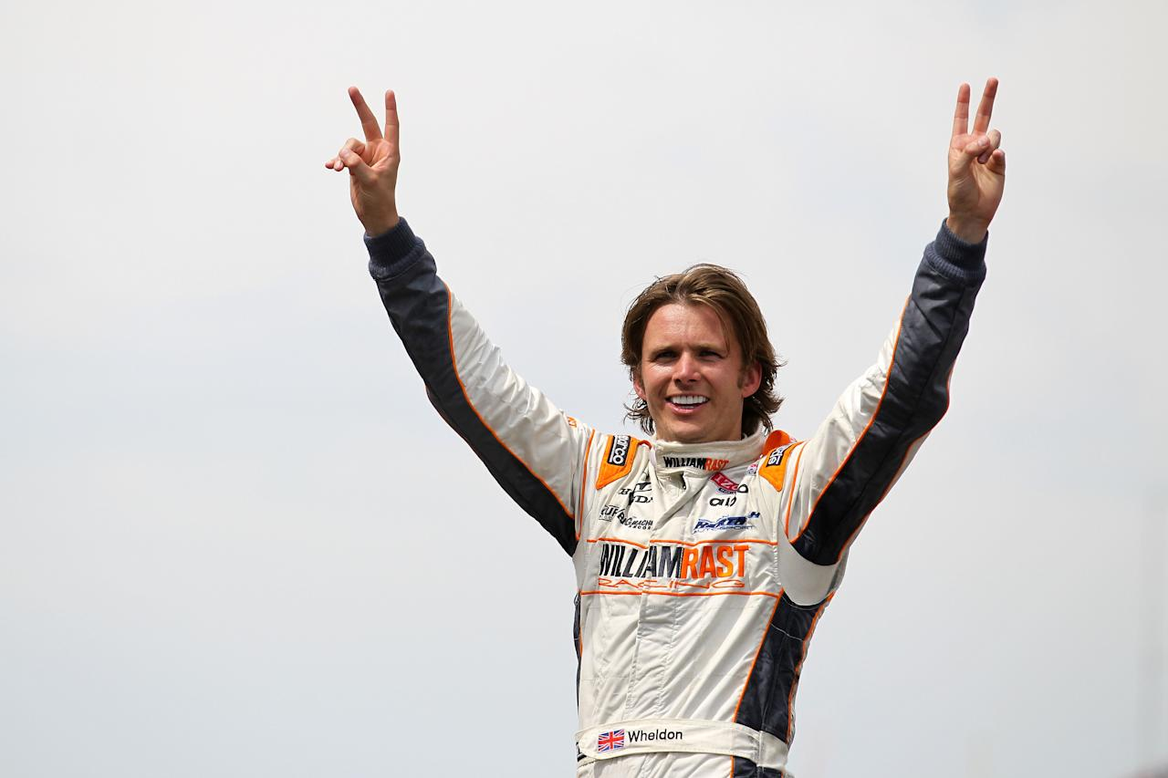 INDIANAPOLIS, IN - FILE: Dan Wheldon of England, driver of the #98 William Rast-Curb/Big Machine Dallara Honda, celebrates at the start/finish line after winning the IZOD IndyCar Series Indianapolis 500 Mile Race at Indianapolis Motor Speedway on May 29, 2011 in Indianapolis, Indiana. Wheldon died today, October 16, 2011 in Las Vegas, Nevada during the IZOD IndyCar World Championships when his car was involved in a 15-car wreck.  (Photo by Nick Laham/Getty Images)