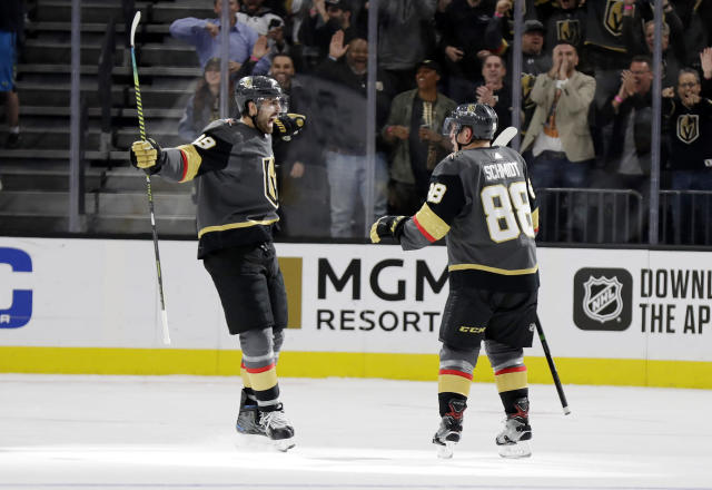 Vegas Golden Knights right wing Alex Tuch (89) and defenseman Nate Schmidt celebrate a Golden Knights score against the St. Louis Blues during the third period of an NHL hockey game Thursday, Feb. 13, 2020, in Las Vegas. Both players had goals in the period. The Golden Knights won 6-5 in overtime. (AP Photo/Isaac Brekken)