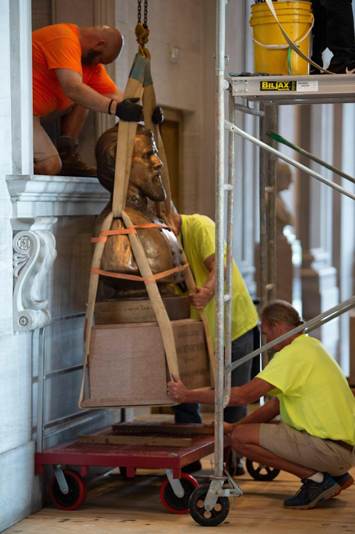 The Nathan Bedford Forrest bust is removed from the State Capitol by workers Friday, July 23, 2021 in Nashville, Tenn.  The State Building Commission on Thursday gave approval for the relocation of the Forrest bust to the Tennessee State Museum, a final step in a process that has taken more than a year since Gov. Bill Lee first said it was time for the statue to be moved.