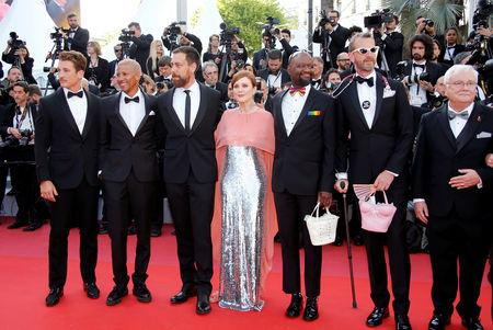 "72nd Cannes Film Festival - Red Carpet Arrivals - Cannes, France, May 16, 2019. Director, cast members and guests of the ""5B"" movie Dan Krauss, Guy Vandenberg, Cliff Morrison, Julianne Moore, Steve Williams, Miles Teller and Keiynan Lonsdale pose. REUTERS/Jean-Paul Pelissier"