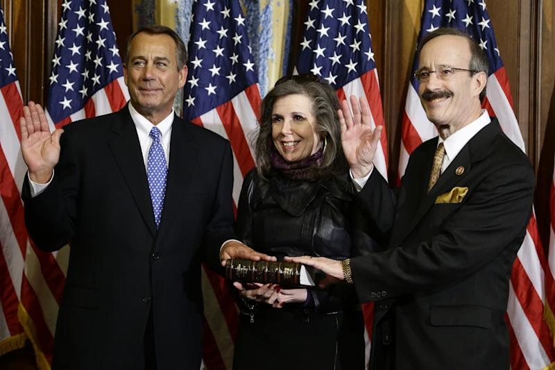 FILE - In this Jan. 3, 2013, file photo, House Speaker John Boehner of Ohio performs a mock swearing in for Rep. Eliot Engel, D-N.Y., Thursday, Jan. 3, 2013, on Capitol Hill in Washington as the 113th Congress begins. Engel, elected in 1988, will be the top Democrat on the House Foreign Affairs Committee. (AP Photo/Charles Dharapak)