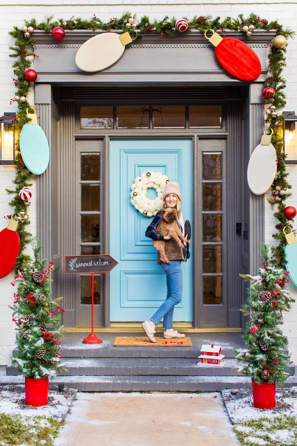 """<p>Who said the twinkle lights have to be real in order to make a big impact on a Christmas porch? This dramatic strand is fun, whimsical, and wow-worthy: It comes together with wood and paint. (No electricity required!)<br></p><p><strong><em>Get the how-to at <a href=""""https://sugarandcloth.com/jumbo-lights-outdoor-diy-christmas-decorations/"""" rel=""""nofollow noopener"""" target=""""_blank"""" data-ylk=""""slk:Sugar & Cloth"""" class=""""link rapid-noclick-resp"""">Sugar & Cloth</a>.</em></strong></p>"""