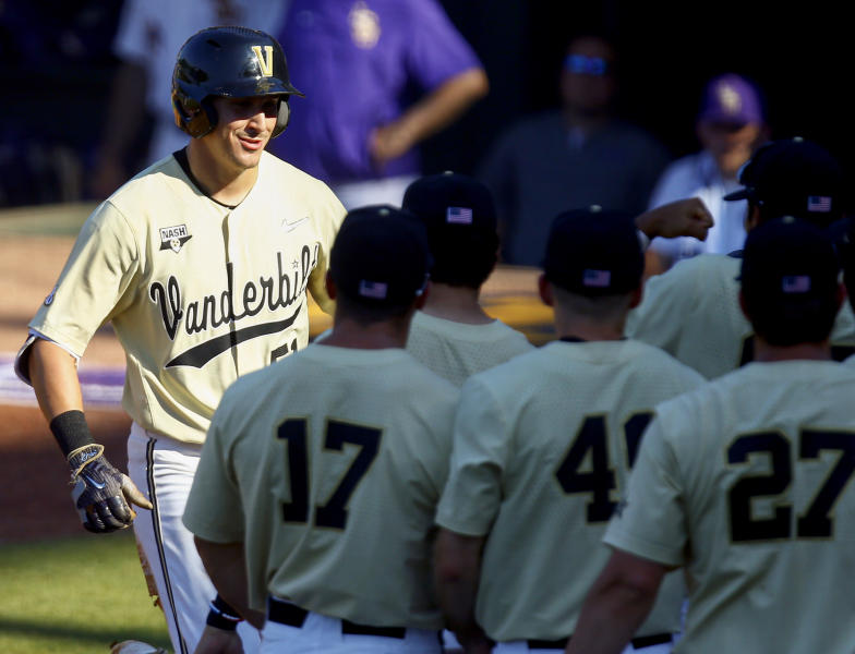 Vanderbilt's JJ Bleday smiles as he greets teammates after his solo home run during the third inning of the Southeastern Conference tournament NCAA college baseball game against LSU, Saturday, May 25, 2019, in Hoover, Ala. (AP Photo/Butch Dill)