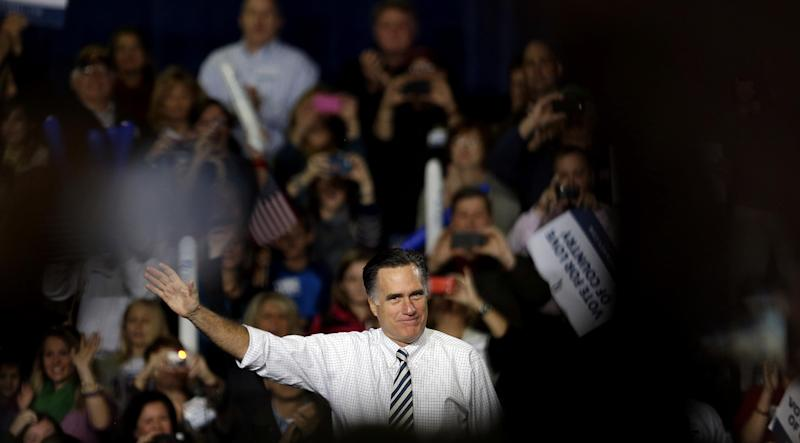 Republican presidential candidate, former Massachusetts Gov. Mitt Romney steps on stage to speak at a campaign event at the Iowa Events Center Sunday, Nov. 4, 2012, in Des Moines, Iowa. (AP Photo/David Goldman)