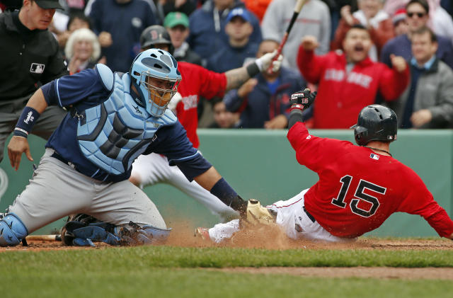 Tampa Bay Rays catcher Jose Molina puts the tag on Boston Red Sox's Dustin Pedroia (15), who is out trying to score on a double by designated hitter David Ortiz, during the seventh inning in the first baseball game of a doubleheader at Fenway Park in Boston, Thursday, May 1, 2014. (AP Photo/Elise Amendola)