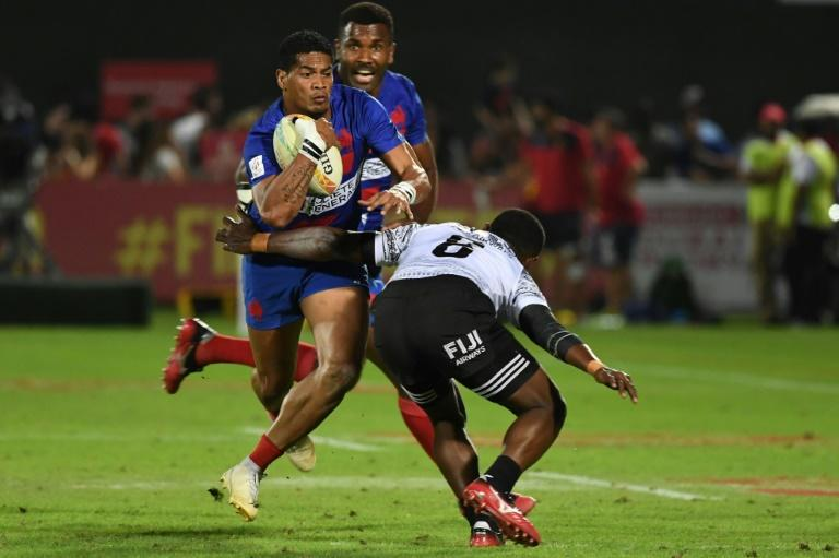 On the run: Remi Siega of France is tackled by Meli Derenalagi of Fiji