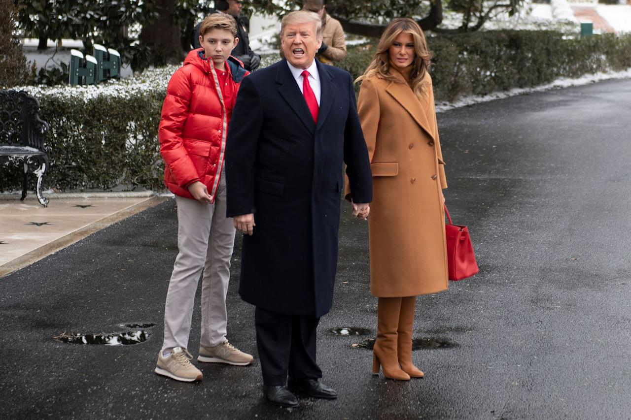 "<p>As the First Lady departed the White House for Palm Beach, she opted for a camel coat by <a rel=""nofollow"" href=""https://www.net-a-porter.com/us/en/Shop/Designers/Roksanda/Clothing?"">Roksanda</a> with matching <a rel=""nofollow"" href=""https://www.matchesfashion.com/us/products/Gianvito-Rossi-Nappa-85-stacked-block-heel-boots-1209683?"">Gianvito Rossi</a> boots. Melania gave the monochrome look a pop of color with a <a rel=""nofollow"" href=""https://www.hermes.com/us/en/story/106191-birkin?"">red Hermés bag</a>. </p><p><a rel=""nofollow"" href=""https://www.matchesfashion.com/us/products/Gianvito-Rossi-Nappa-85-stacked-block-heel-boots-1209683?"">SHOP NOW</a><em>Nappa 85 Stacked Block-heel Boots, Gianvito Rossi, $975</em><br></p>"