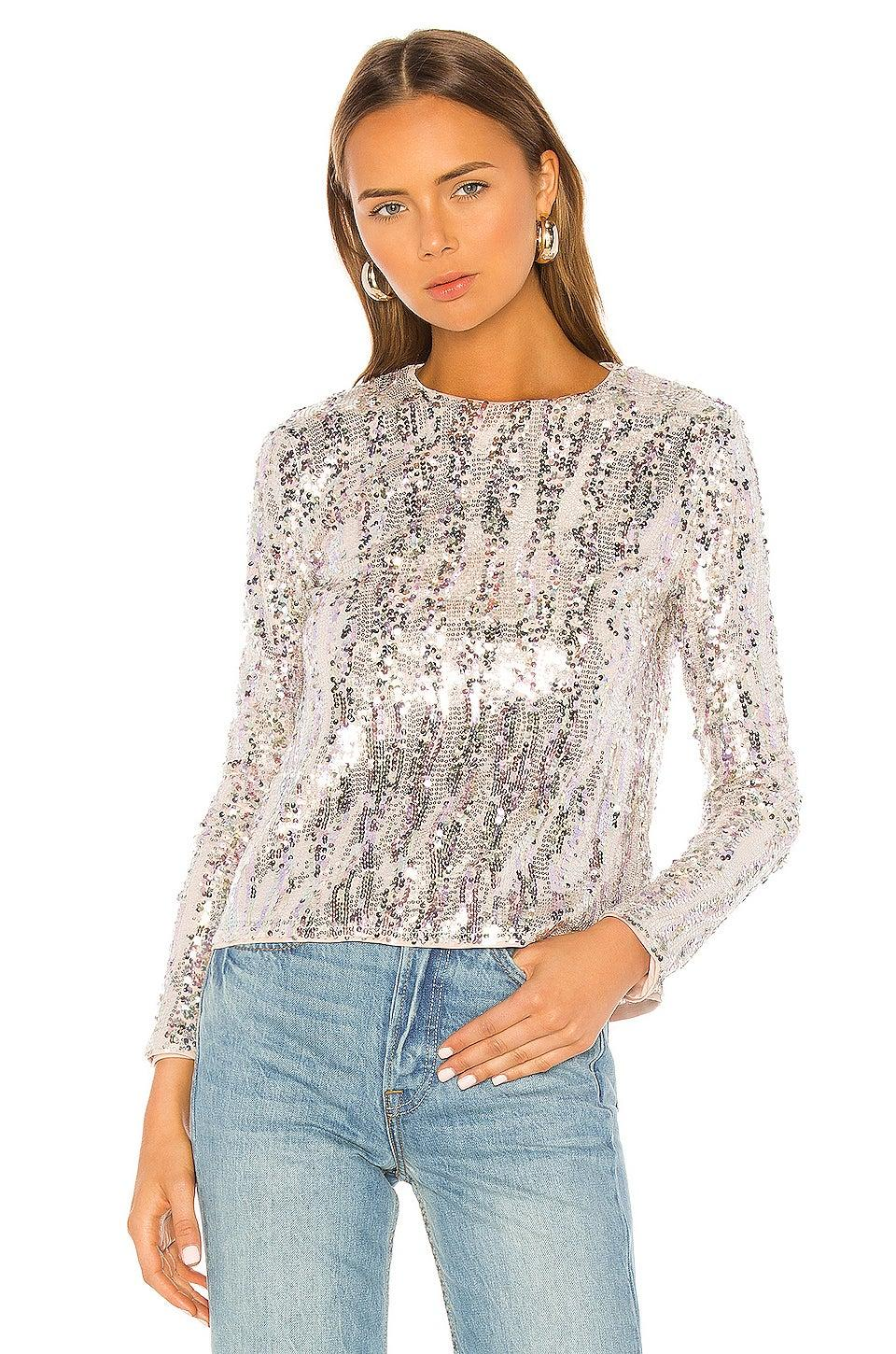 """<strong><h3><a href=""""http://revolve.com"""" rel=""""nofollow noopener"""" target=""""_blank"""" data-ylk=""""slk:Holiday Season Sequins"""" class=""""link rapid-noclick-resp"""">Holiday Season Sequins</a></h3></strong><a href=""""https://www.instagram.com/patsyadaum/https://www.instagram.com/patsyadaum/"""" rel=""""nofollow noopener"""" target=""""_blank"""" data-ylk=""""slk:Patsy Daum, 16"""" class=""""link rapid-noclick-resp""""><strong>Patsy Daum, 16</strong></a><br>Since the holiday season is upon us, and I am inevitably in need of the perfect holiday outfit. This <a href=""""https://www.revolve.com/majorelle-christiana-top/dp/MALR-WS416/"""" rel=""""nofollow noopener"""" target=""""_blank"""" data-ylk=""""slk:silver sequin top from Majorelle"""" class=""""link rapid-noclick-resp"""">silver sequin top from Majorelle</a> is great because it is definitely festive but nondenominational as well. It is also suitable for any occasion since silver is great for any time of year. I definitely picture myself wearing these with a nice pair of white or blue jeans depending on the formalness of the event I plan to wear it at. When Black Friday finally arrives, this will definitely be the first thing I purchase as I know there is always room for a little sparkle in your wardrobe.<br><br><strong>Majorelle</strong> Christiana Top, $, available at <a href=""""https://www.revolve.com/majorelle-christiana-top/dp/MALR-WS416/"""" rel=""""nofollow noopener"""" target=""""_blank"""" data-ylk=""""slk:Revolve"""" class=""""link rapid-noclick-resp"""">Revolve</a>"""