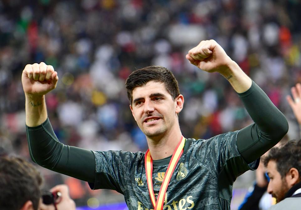 Real Madrid's Belgian goalkeeper Thibaut Courtois celebrates after winning the Spanish Super Cup final between Real Madrid and Atletico Madrid on January 12, 2020, at the King Abdullah Sports City in the Saudi Arabian port city of Jeddah. (Photo by Giuseppe CACACE / AFP) (Photo by GIUSEPPE CACACE/AFP via Getty Images)
