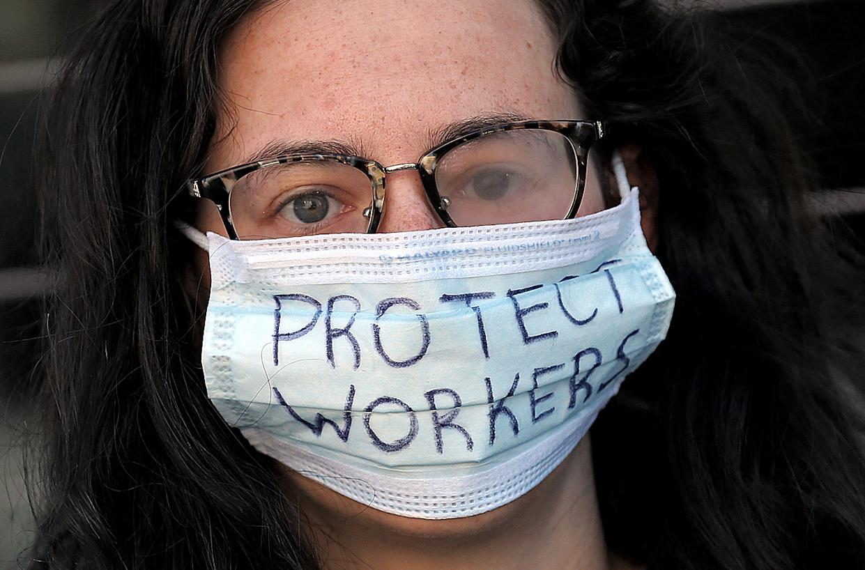 """BOSTON, MA. - APRIL 7: A protester outside the South End Whole Foods to demand """"adequate protections"""" for grocery workers during the COVID-19 pandemic on April 7, 2020 in Boston, Massachusetts. (Staff Photo By Matt Stone/MediaNews Group/Boston Herald)"""