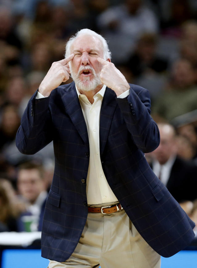 Gregg Popovich indicates where the eyes are, and that they should be open. Helpful. (Getty)