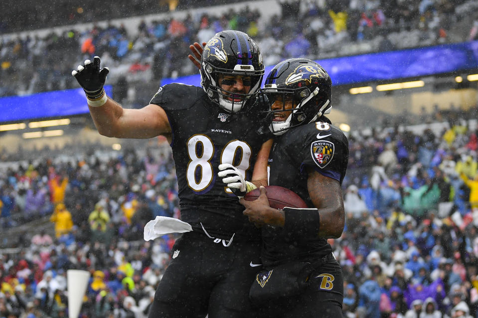 Baltimore Ravens quarterback Lamar Jackson (8) celebrating his touchdown with teammate tight end Mark Andrews (89)