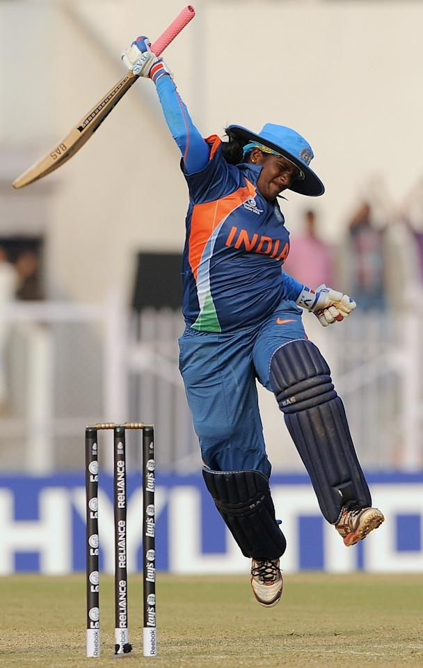 Indian cricketer Thirush Kamini jumps in the air as she celebrates her century during the inaugural match of the ICC Women's World Cup 2013 between India and West Indies at the Cricket Club of India's Brabourne stadium in Mumbai on January 31, 2013.     AFP PHOTO/Indranil MUKHERJEE        (Photo credit should read INDRANIL MUKHERJEE/AFP/Getty Images)