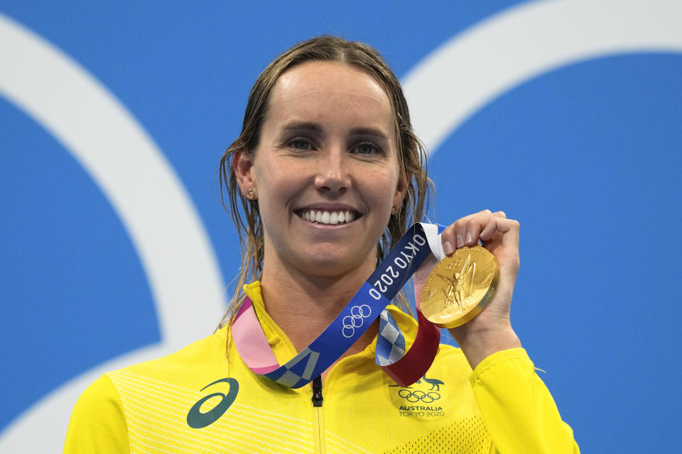 Emma Mckeon, of Australia, poses after winning the gold medal in the women's 50-meter freestyle final at the 2020 Summer Olympics, Sunday, Aug. 1, 2021, in Tokyo, Japan. (AP Photo/Gregory Bull)