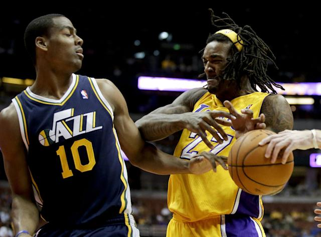 Los Angeles Lakers center Jordan Hill, right, battles Utah Jazz guard Alec Burks for the ball during the first half of a preseason NBA basketball game in Anaheim, Calif., Friday, Oct. 25, 2013. (AP Photo/Chris Carlson)