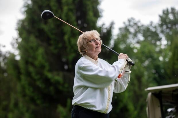 Moira Colbourne tees off. A longtime high-level field hockey player, Colbourne's favourite part of the round is driving — she says using the driver reminds her of using a field hockey stick. (Ben Nelms/CBC - image credit)