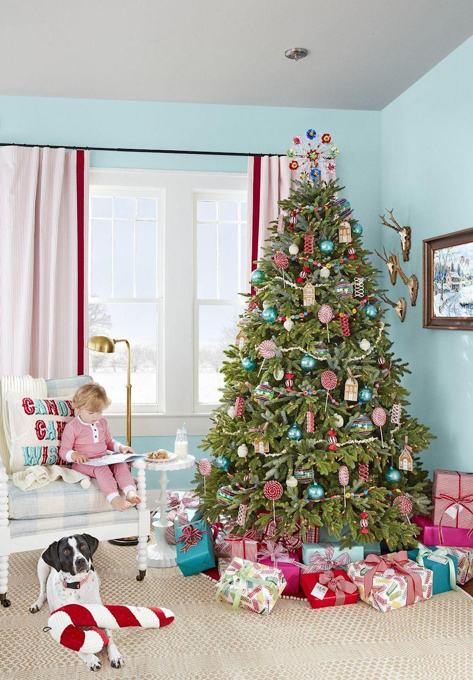 """<p>Who says you have to stick to red and green at Christmastime? This homeowner opted for lighter hues—even pinks, blues, and soft yellows—and managed to keep things looking festive. </p><p><a class=""""link rapid-noclick-resp"""" href=""""https://www.amazon.com/Northlight-Coated-Ribbon-Christmas-Ornaments/dp/B077QHG2LZ?tag=syn-yahoo-20&ascsubtag=%5Bartid%7C10050.g.1247%5Bsrc%7Cyahoo-us"""" rel=""""nofollow noopener"""" target=""""_blank"""" data-ylk=""""slk:SHOP CANDY CHRISTMAS ORNAMENTS"""">SHOP CANDY CHRISTMAS ORNAMENTS </a></p>"""