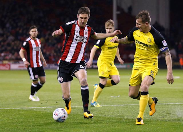 "Soccer Football - Championship - Sheffield United vs Burton Albion - Bramall Lane, Sheffield, Britain - March 13, 2018 Sheffield United's Chris Basham in action with Burton Albion's Kyle McFadzean Action Images/Ed Sykes EDITORIAL USE ONLY. No use with unauthorized audio, video, data, fixture lists, club/league logos or ""live"" services. Online in-match use limited to 75 images, no video emulation. No use in betting, games or single club/league/player publications. Please contact your account representative for further details."