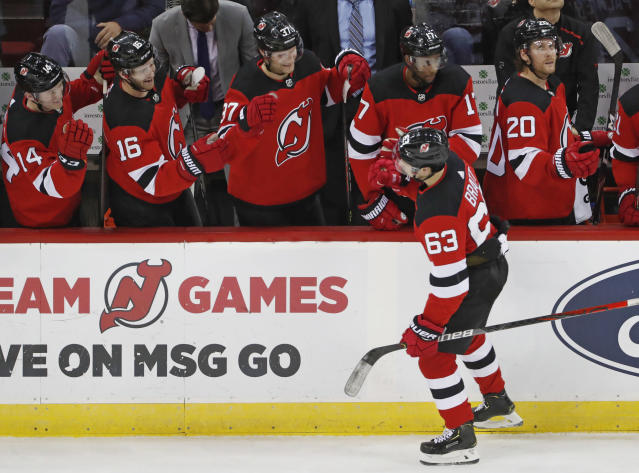 New Jersey Devils left wing Jesper Bratt (63) greets teammates after scoring a goal during the third period of an NHL hockey game Detroit Red Wings, Thursday, Feb. 13, 2020, in Newark, N.J. (AP Photo/Kathy Willens)