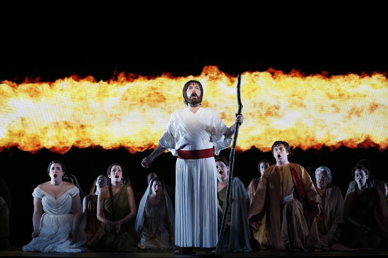 """In this April 12, 2013 photo provided by the New York City Opera, David Salsbery Fry, center, sings the title role during the New York City Opera's final dress rehearsal of Rossini's rarely performed """"Mose in Egitto (Moses in Egypt),"""" at the City Center in New York. (AP Photo/New York City Opera, Carol Rosegg)"""