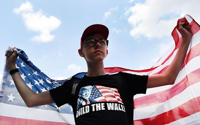 <p>A Pro-Trump supporter demonstrates outside the U.S. Embassy in support of President Trump's visit to the U.K., in London, July 14, 2018. (Photo: Andy Rain/EPA-EFE/REX/Shutterstock) </p>