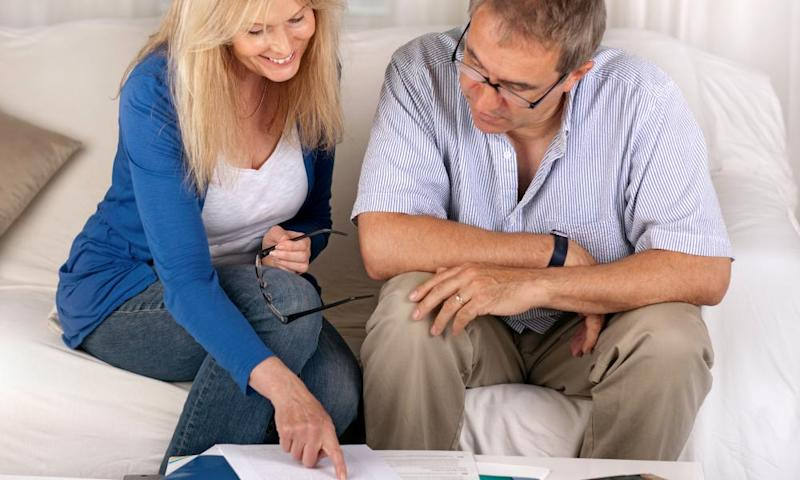 Middle-aged couple looking at financial papers