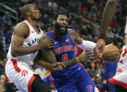 Detroit Pistons center Andre Drummond (0) drives against Toronto Raptors forward Serge Ibaka during the first half of an NBA basketball game Wednesday, Dec. 18, 2019, in Detroit. (AP Photo/Duane Burleson)
