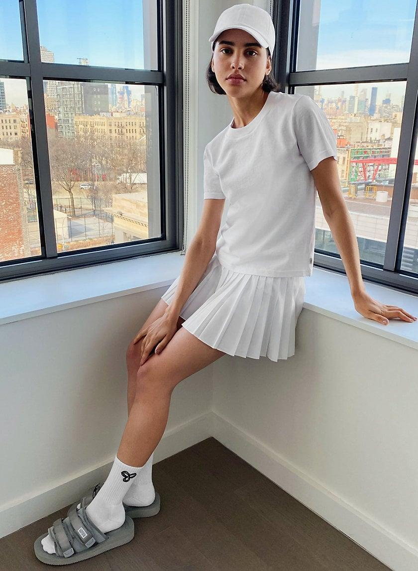 <p>Tennis skirts are back in style, and we like this classic <span>Aritzia Tennis Skirt</span> ($68). It comes in a bunch of colors, but we're partial to the white.</p>