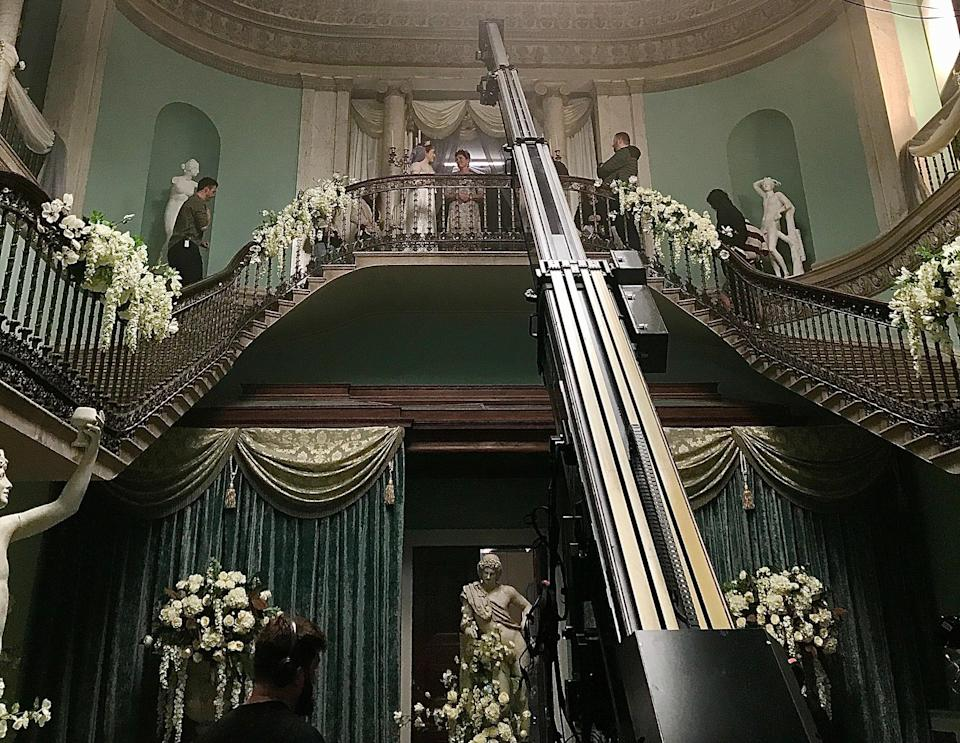The foyer of the Ingenue Ball in the third episode. The episode is directed by Tom Verica, who's no stranger to the Shondaland family. He's directed episodes of Scandal, Private Practice, For the People, Station 19 and played Sam Keating on How to Get Away with Murder.