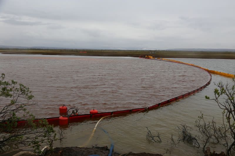 FILE PHOTO: A view shows water barriers during recovery works following a diesel fuel leak at a thermal power station in Krasnoyarsk Region