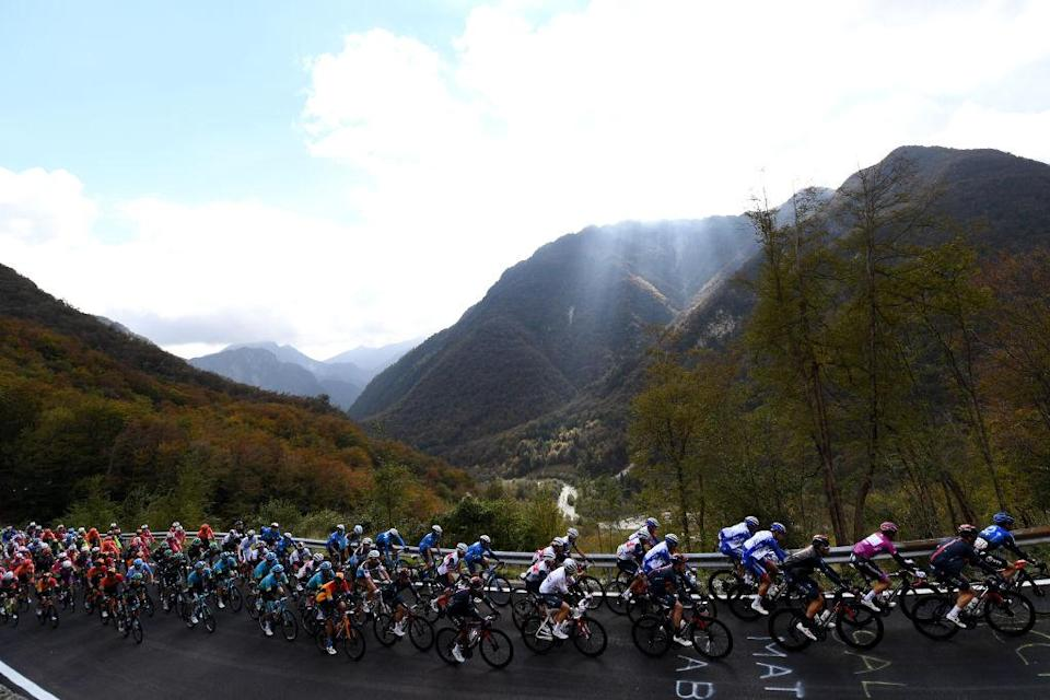 PIANCAVALLO ITALY OCTOBER 18 Arnaud Demare of France and Groupama FDJ Purple Points Jersey Tao Geoghegan Hart of The United Kingdom and Team INEOS Grenadiers Ben Swift of The United Kingdom and Team INEOS Grenadiers Sella Chianzutan 955m Peloton Landscape Mountains during the 103rd Giro dItalia 2020 Stage 15 a 185km stage from Base Aerea Rivolto Frecce Tricolori to Piancavallo 1290m girodiitalia Giro on October 18 2020 in Piancavallo Italy Photo by Tim de WaeleGetty Images