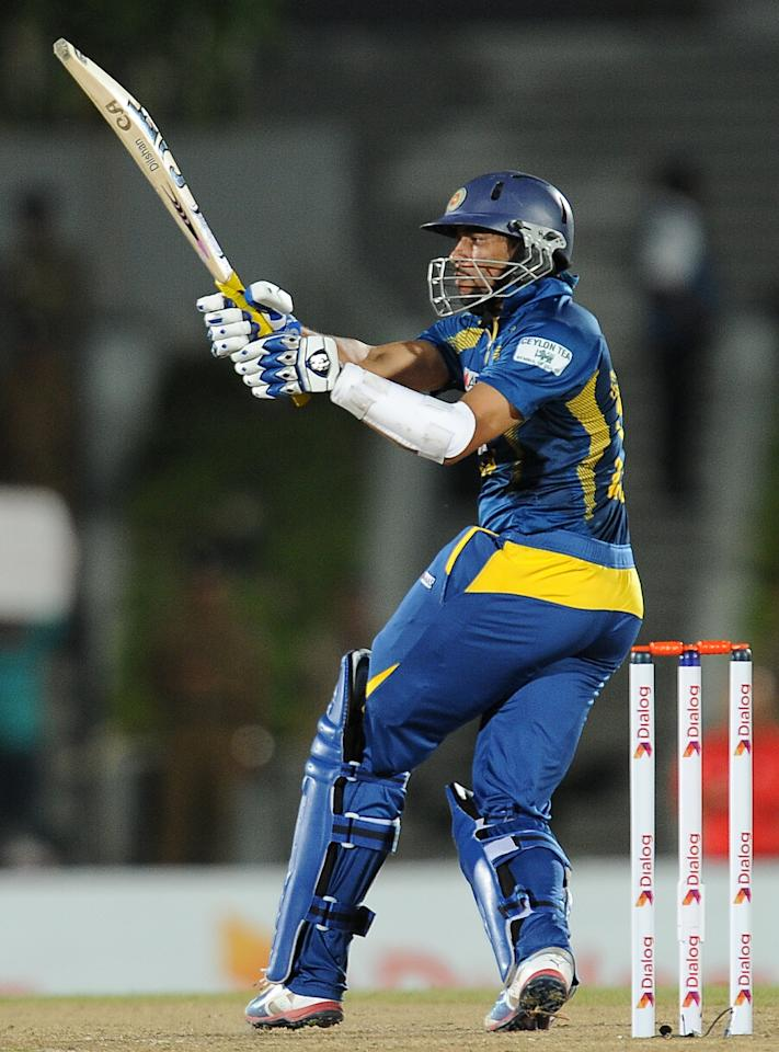 Sri Lankan batsman Tillakaratne Dilshan plays a shot during the third and final Twenty20 cricket match between Sri Lanka and South Africa at the Suriyawewa Mahinda Rajapakse International Cricket Stadium in the southern district of Hambantota on August 6, 2013. AFP PHOTO/ LAKRUWAN WANNIARACHCHI