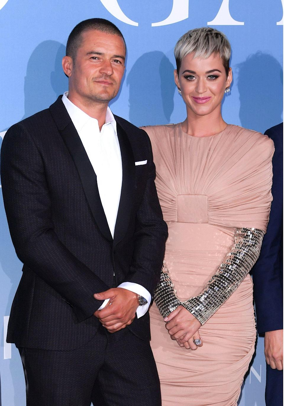 It's the first time Orlando and Katy have shared a red carpet. [Photo: Getty]