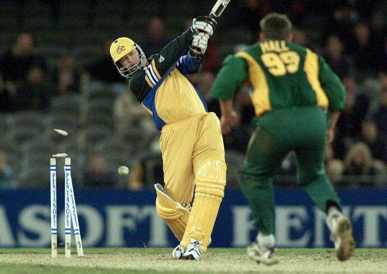 Australian captain Steve Waugh (L) is clean bowled by South African bowler Andrew Hall (R) in an exciting climax to their one day cricket match being played under a closed roof at the Colonial Stadium in Melbourne 18 August 2000.  Being played in the middle of winter in Melbourne, Australia tied with South Africa's 226-8 but leads the three match series 1-0.  (ELECTRONIC IMAGE)  AFP PHOTO/William WEST